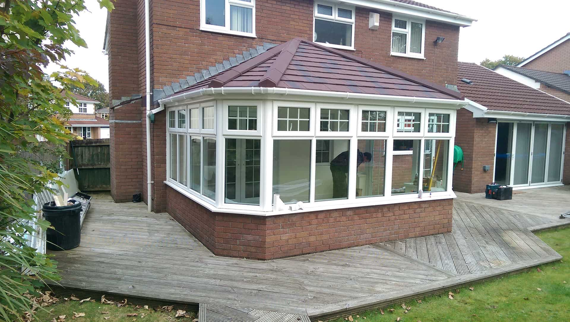 solid conservatory roof with red tiles