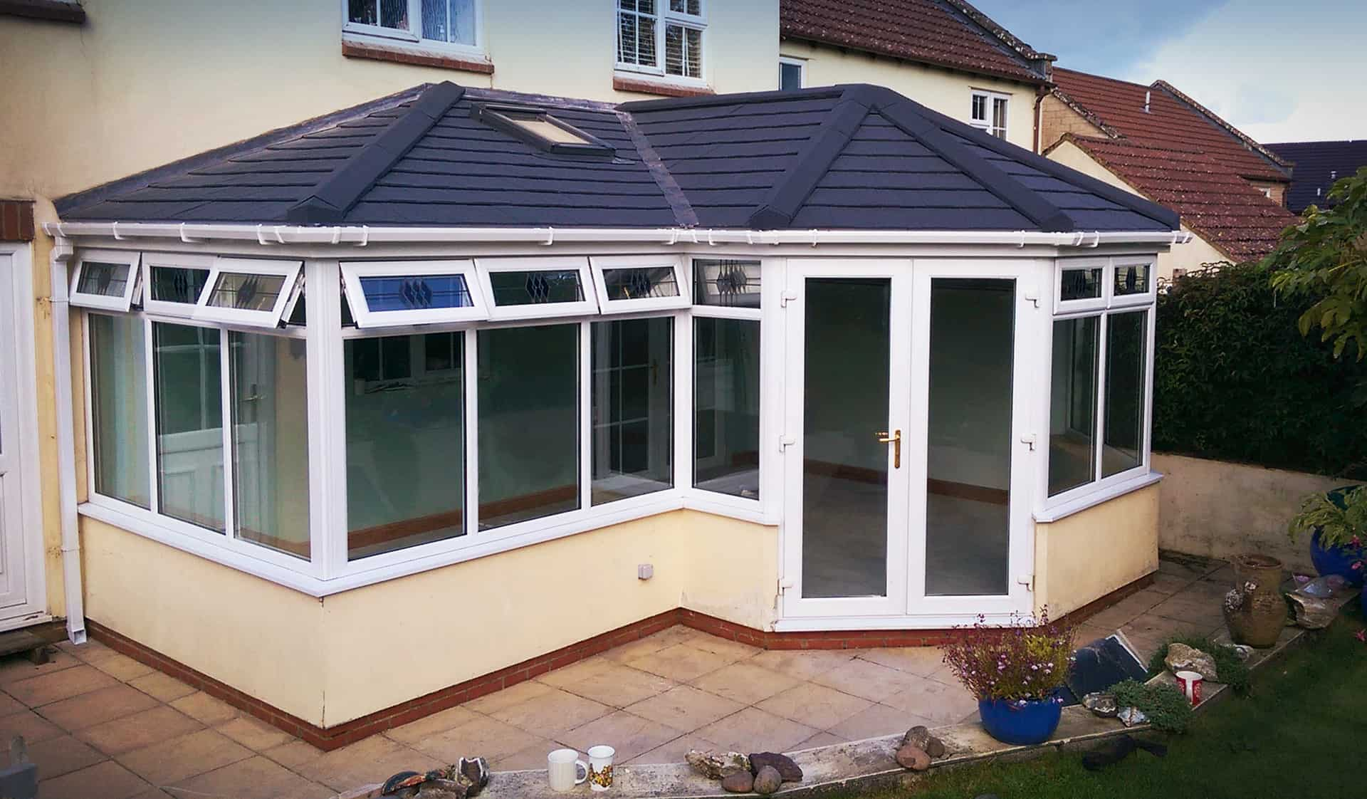 tiled conservatory roof with dark tiles